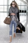18 Rosie Huntington-Whiteley makes her way through Heathrow