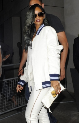 06 Rihanna working a men's Roberto Cavalli varsity jacket like only she can
